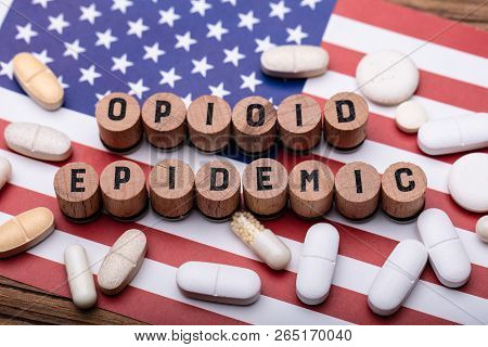 Opioid Epidemic Text With Spilled Prescription Pills Over American Flag