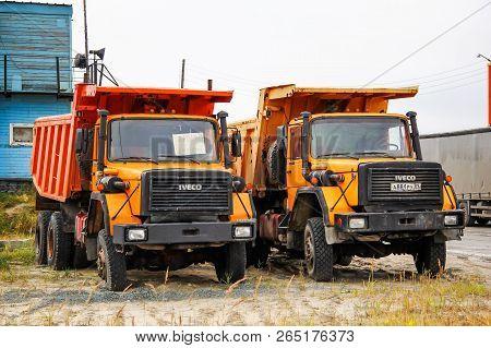 Gubkinsky, Russia - September 8, 2014: Orange Dump Trucks Iveco 330-30 Anw In The City Street.