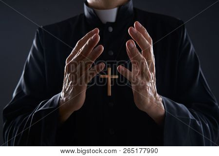Priest open hands arms praying offering oblation
