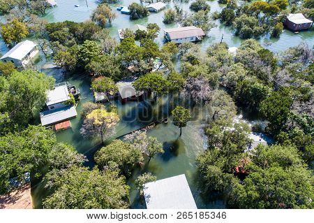 Looking Down On Flooded Homes And Houses Above Aerial Drone View Above Entire Community Damaged And