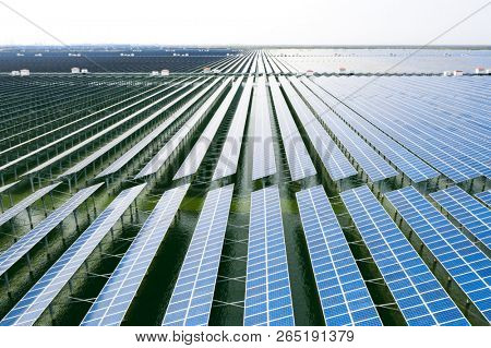 solar panels in aerial view. Blue solar panels. background of photovoltaic modules for renewable energy