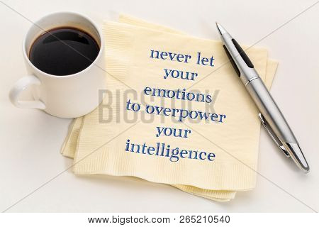 Never let your emotions to overpower your intelligence - handwriting on a napking with a cup of coffee