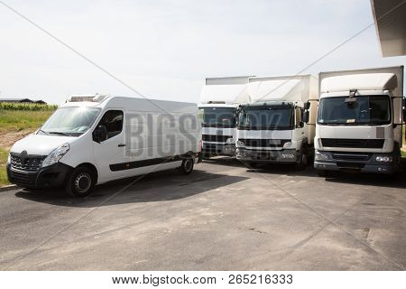 Several Delivery Van And White Logistic Truck For Service Transportation In Distribution Park