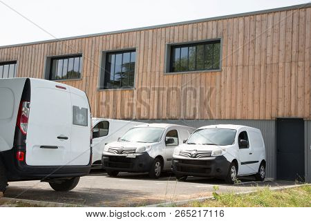 Delivery Van In Row Service Trucks And Cars Front Entrance Warehouse Distribution Logistic Plant