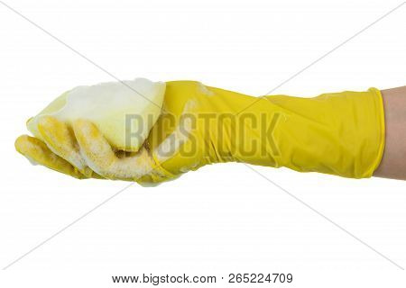 Female Hand In Yellow Household Glove Holding A Sponge For Washing Dishes Isolated On White Backgrou