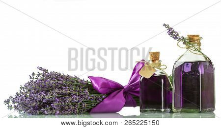 Fragrant Lavender Water And Fresh Branch Isolated On White Background