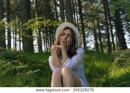 Portrait Of  Beautiful Woman Relaxing In Nature. Beautiful Woman Relaxing In Nature. Healthy Lifesty
