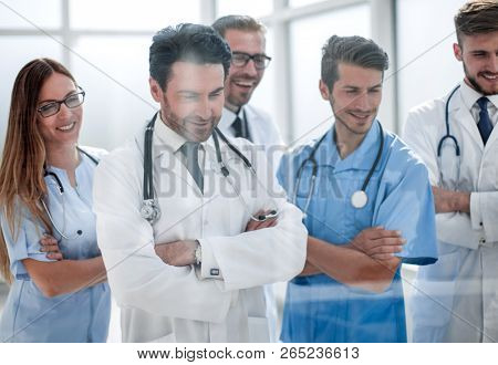 group of doctors looking at the desktop in the meeting room