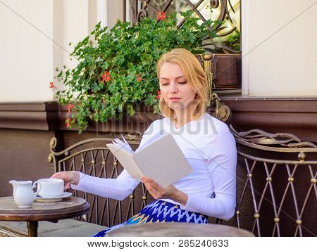 Mug of good coffee and pleasant book best combination for perfect weekend. Girl drink coffee every morning at same place daily ritual. Woman have drink cafe terrace outdoors. Bookworm leisure concept poster
