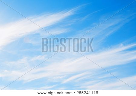 Blue sky background with white dramatic colorful clouds and sunlight. Beautiful sky landscape scene. Natural sky background, sky sunny landscape.Sunny sky background