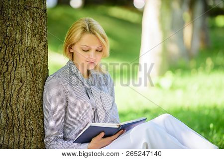 Books Every Girl Should Read. Girl Concentrated Sit Park Read Book Nature Background. Reading Inspir