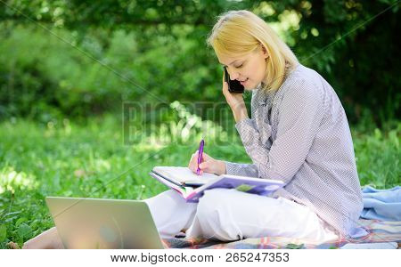 Woman With Laptop And Smartphone Working Outdoors. Girl Use Modern Technology For Business. Use Oppo