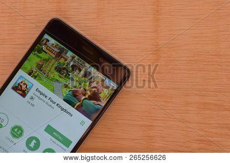 Bekasi, West Java, Indonesia. October 27, 2018 : Empire: Four Kingdoms Dev App On Smartphone Screen.