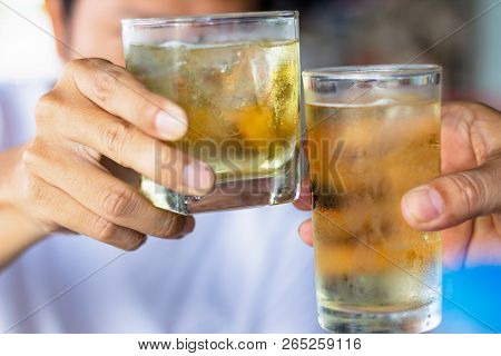 Close Up Two Men Clinking Glasses Of Whiskey Drinking Alcoholic Beverage Together. Cheers Friends Cl
