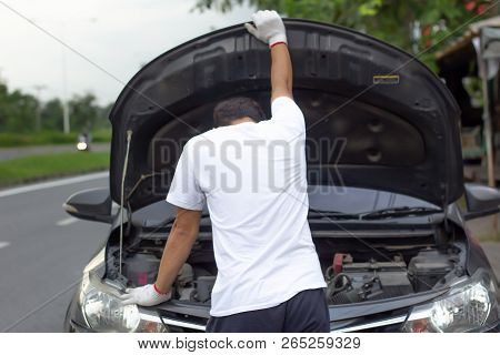 Mechanic Wearing Gloves Open Car Hood Checking Car Engine Oil While Parked On The Road After Car Bre