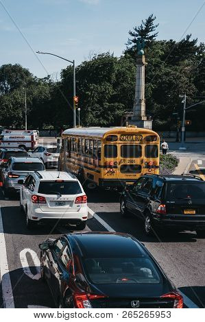 New York, Usa - May 30, 2018: School Bus And Cars In Traffic On A Street In Brooklyn, New York, Usa.