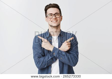 Pleasant Friendly-looking Charming Smiling Guy In Glasses And Blue Shirt Crossing Hands On Body, Poi