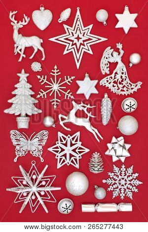 Traditional silver Christmas decorations collection on red background. Christmas greeting card for the festive season.