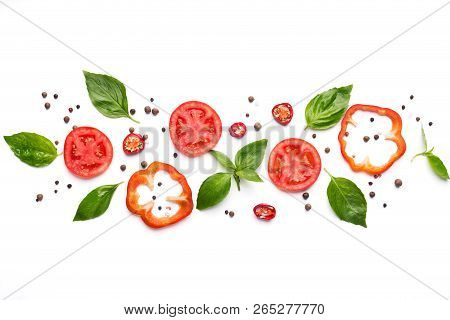Food Art. Creative Composition Of Cut Pepper, Tomato, Basil Leaves And Spices On White Background, T