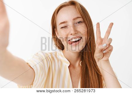 Enjoying Cool Summer Holidays. Stylish Beautiful Redhead Woman With Cute Freckles Sticking Out Tongu