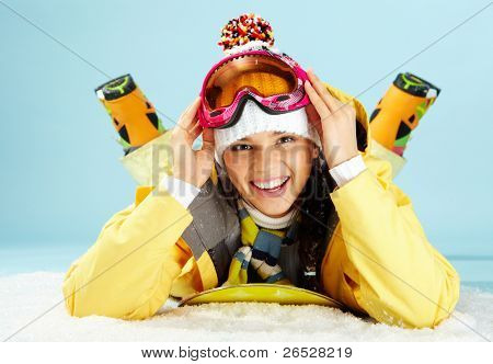 Portrait of happy skateboarder looking at camera