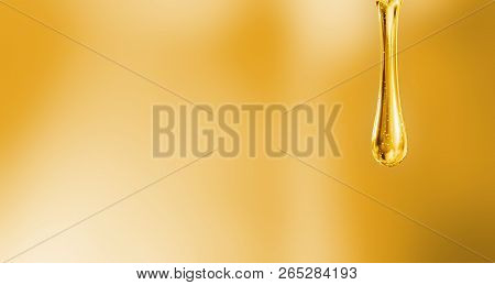 Liquid Droplet Of Motor Oil On Orange Background