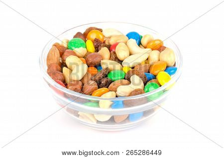 Trail Mix In Glass Bowl. Snack Mix. Almonds, Cashews, Peanuts, Hazelnuts, Raisins And Colorful Choco