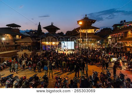 PATAN, NEPAL - OCTOBER 25, 2018: The crowd gathers on Patan Durbar Square for an interview of fashion designer Prabal Gurung at  Photo Kathmandu 2018 festival.