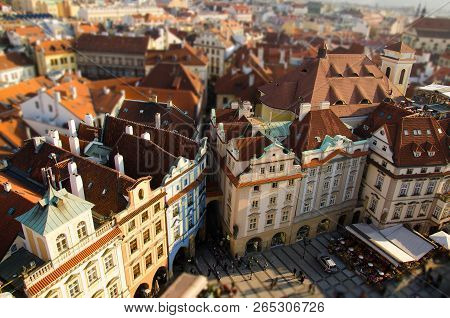 View Of Old Town Square With People Crowd, Old Buildings With Red Tiled Roofs And Old Streets In The