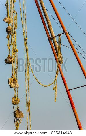 Here You Can See A Part Of Chinese Fishing Nets Mechanism - Several Stone Sinkers Tied To A Rope Han