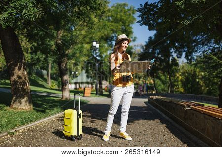 Young Joyful Traveler Tourist Woman In Yellow Summer Casual Clothes, Hat With Suitcase City Map Walk