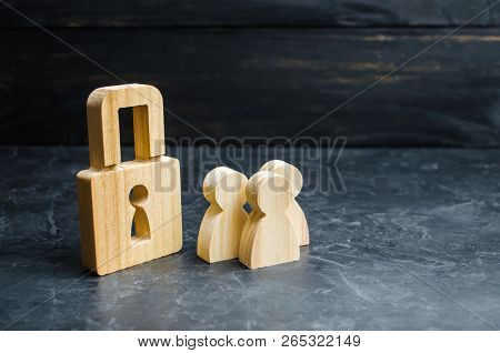 A Group Of People Near The Wooden Padlock. The Concept Of Security And Protection, Safety Of Life, P