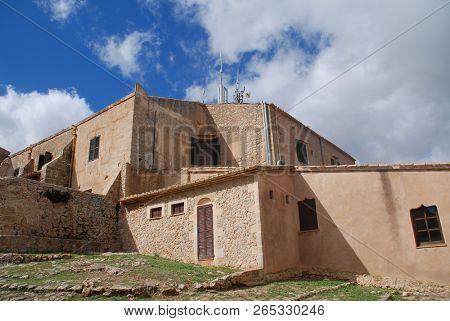 The medieval monastery and church on the summit of the Puig de Maria at Pollensa on the Spanish island of Majorca.