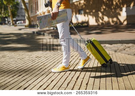 Cropped Image Of Traveler Tourist Woman In Yellow Casual Clothes With Suitcase City Map Walking In C