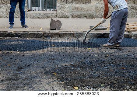 Bad Road Street Resurfacing. Fresh Asphalt Construction.