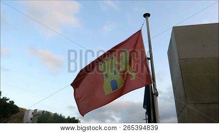 Alora, Spain - August 21, 2018: Local Flag Of Village Of Alora Municipality Blowing In Early Morning