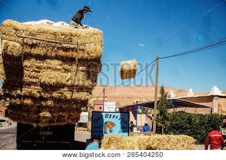 Ait Benhaddou, Morocco - March 19, 2018: A Hay Dealer Trading Bales Of Hay At A Weekly Market In A S