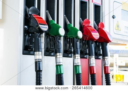 Gasoline And Diesel Distributor At The Gas Station. Gas Pump Nozzles. Petrol Filling Gun Close-up At