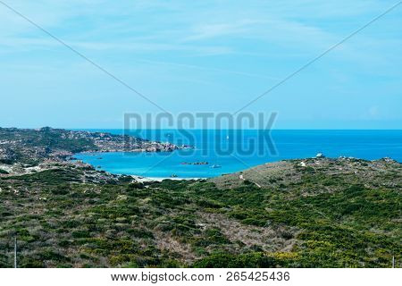 a view over the Cala Stagnolu cove, on the Southern coast of Corsica, France, with the calm Mediterranean sea in the background