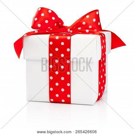 White Gift Box With Red Polka Dot Ribbon Bow Isolated On White Background