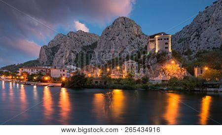 City Of Omis, Dalmatia, Croatia. Blue Hour Landscape View In Historical City Centre Of Omis And Ceti