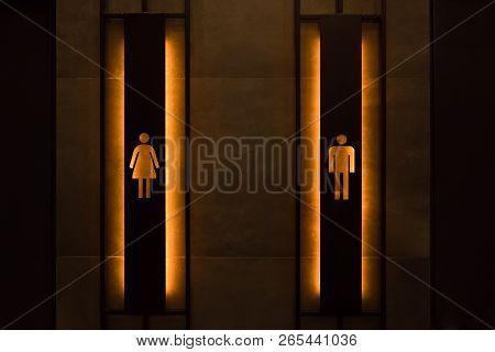 Restroom Concept. Restroom Sign On A Toilet Door. Female And Male Restroom Sign. Restroom Signs In P