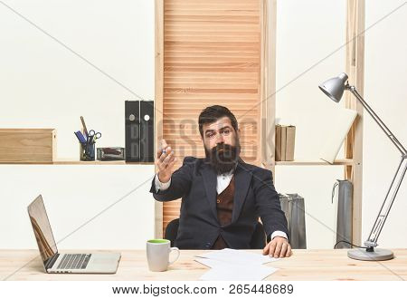 Confident Businessman. Business Man Working In Office Inviting To Come. Businessman In Suit In Offic