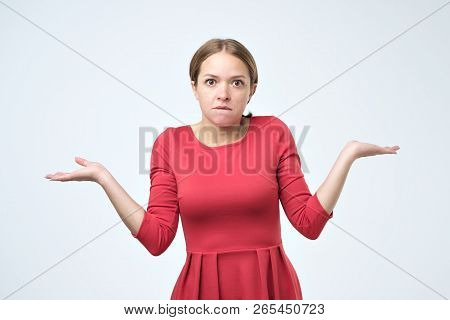 Unsure Woman With Shrug And Hands Out Gesturing Uncertainty