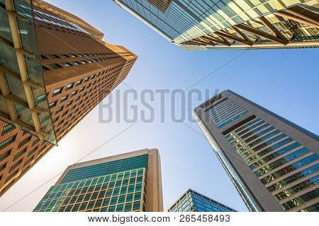 Tokyo, Japan - April 20, 2017: Sky High-rise Facade Bottom View. Panoramic Wide Angle View And Persp
