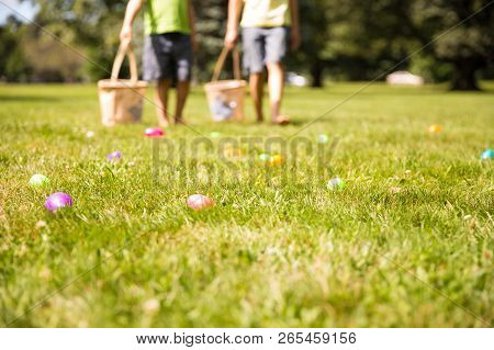 Easter Eggs Hunt. Blurred Silhouettes Of Children With Baskets In Hands. The Concept Of Family Fun A