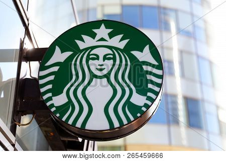 Paris, France - October 16, 2018: Starbucks Coffee Shop Mermaid Logo Is Displayed At The Facade Of A