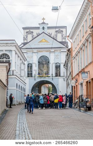 Vilnius, Lithuania - September 28, 2018: Tourist Near The Gate Of Dawn In Vilnius, The Chapel Of Our