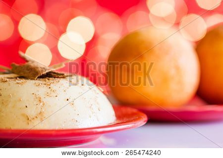 Traditional Colombian Bunuelos (deep Fried Cheese Bread) And Natilla On Christmas Red Background