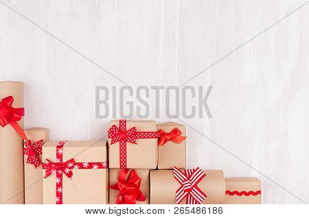 Celebration Gifts Background - Different Presents Of Craft Paper Wrapped With Red Ribbons And Bows O